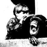 Kid talking to a monkey