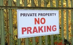 A No Parking sign that read No Pracking